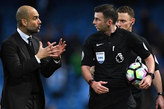 Manchester City's manager Pep Guardiola (L) speaks with referee Michael Oliver after the English Premier League football match between Manchester City and Liverpool on March 19, 2017 (AFP Photo/Paul ELLIS)