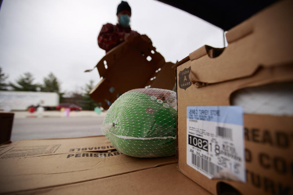 BLOOMINGTON, INDIANA, UNITED STATES - 2020/11/21: A Turkey sits ready to be distributed as members of the Indiana National Guard assist Pantry 279 food bank to distribute Thanksgiving meals at Hoosier Hills food bank. (Photo by Jeremy Hogan/SOPA Images/LightRocket via Getty Images)