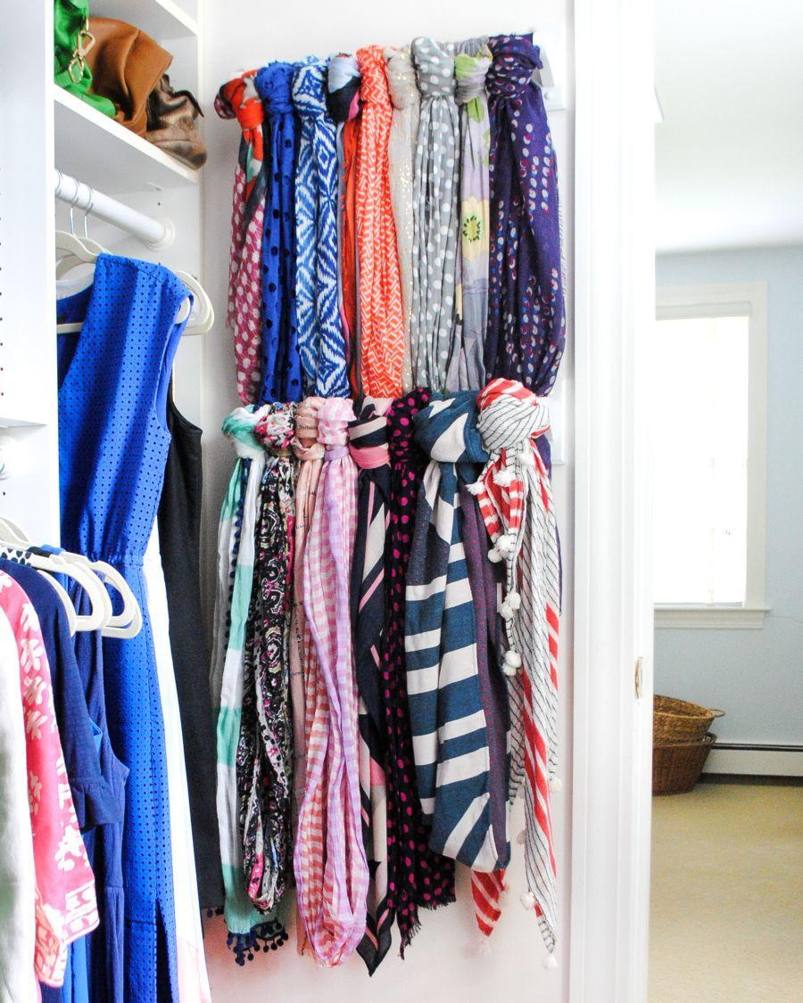 "<p>Instead of storing scarves, belts, and other accessories in boxes or on hangers, take advantage of unused wall space and install a towel bar or hooks to display your collections. <br></p><p>Get the DIY at <a href=""https://www.thechroniclesofhome.com/2016/05/scarf-hanger-closet-organization-ideas.html"" rel=""nofollow noopener"" target=""_blank"" data-ylk=""slk:The Chronicles of Home"" class=""link rapid-noclick-resp"">The Chronicles of Home</a>. </p><p><a class=""link rapid-noclick-resp"" href=""https://www.amazon.com/LuckIn-Adhesive-Towel-Bathroom-Holder/dp/B076PZ288D/ref=sr_1_1?tag=syn-yahoo-20&ascsubtag=%5Bartid%7C10072.g.29994972%5Bsrc%7Cyahoo-us"" rel=""nofollow noopener"" target=""_blank"" data-ylk=""slk:SHOP TOWEL BARS"">SHOP TOWEL BARS</a></p>"