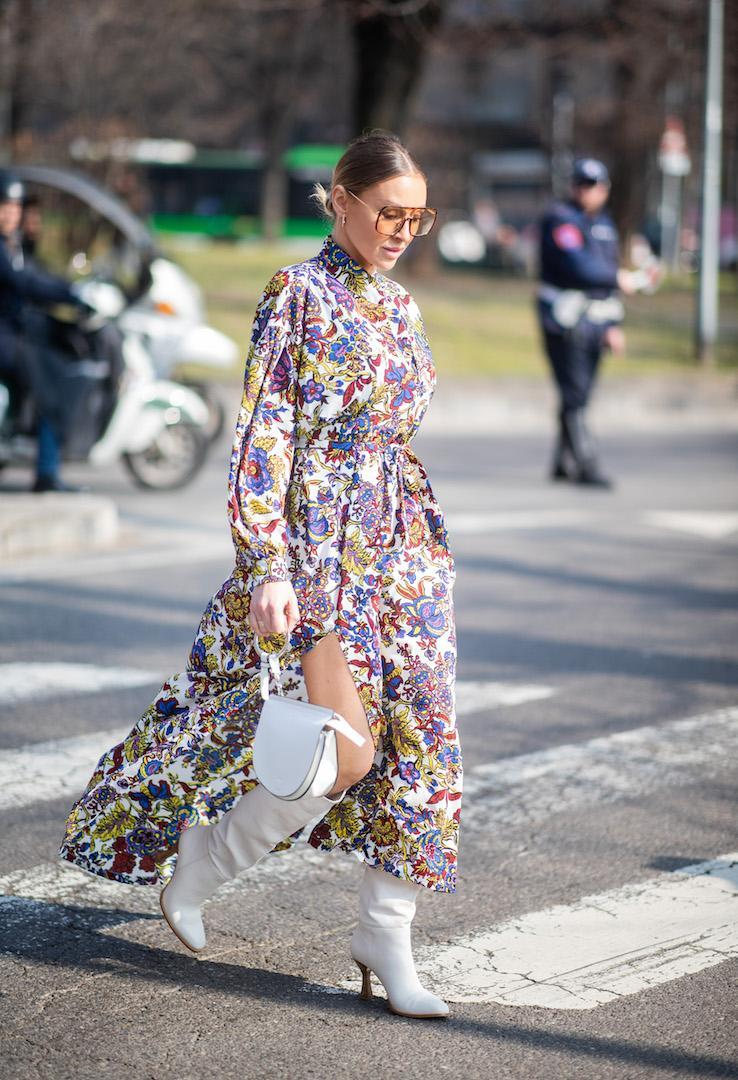 <p>A guest photographed arriving at the Fendi show in a spring-ready floral dress, white knee-high boots and tinted sunnies. <em>[Photo: Getty]</em> </p>