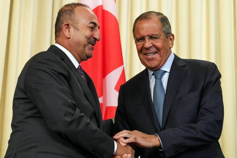 Turkish Foreign Minister Mevlut Cavusoglu (l) met with Russian counterpart Sergei Lavrov in Moscow on Friday