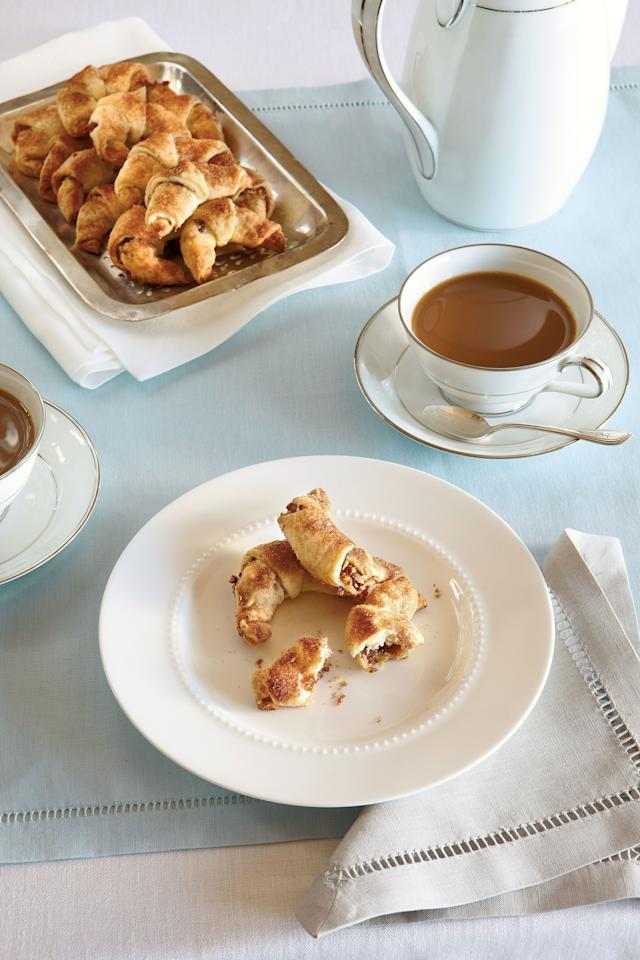 """<p><strong>Recipe:</strong> <strong><a href=""""http://www.myrecipes.com/recipe/peach-pecan-rugelach-50400000117960/"""" target=""""_blank"""">Peach-Pecan Rugelach</a></strong></p> <p> Rugelach are small crescent-shaped cookies that are made with cream cheese dough around various fillings. As the name suggests, our Peach-Pecan Rugelach are filled with peach preserves and chopped pecans. These are topped with a sprinkle of cinnamon-and-sugar mixture, then baked for 15 to 20 minutes. Let these cool completely—if you can—before digging in to these great sweet-and-nutty treats. The taste of toasted pecans mixed with the delicate sweetness of peach preserves will make this one of your favorite go-to treats. This recipe makes about 5-dozen, which should be just enough to share with family and friends!</p>"""