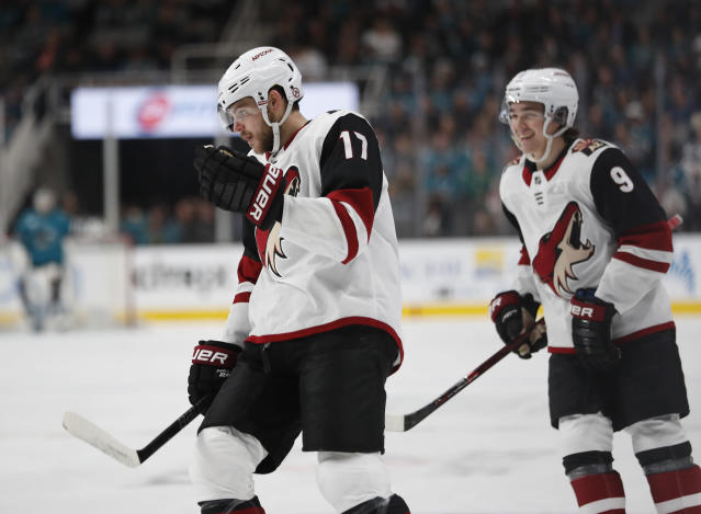 Arizona Coyotes' Alex Galchenyuk (17) and Clayton Keller (9) celebrate after scoring against the San Jose Sharks in the first period of an NHL hockey game in San Jose, Calif., Sunday, Dec. 23, 2018. (AP Photo/Josie Lepe)