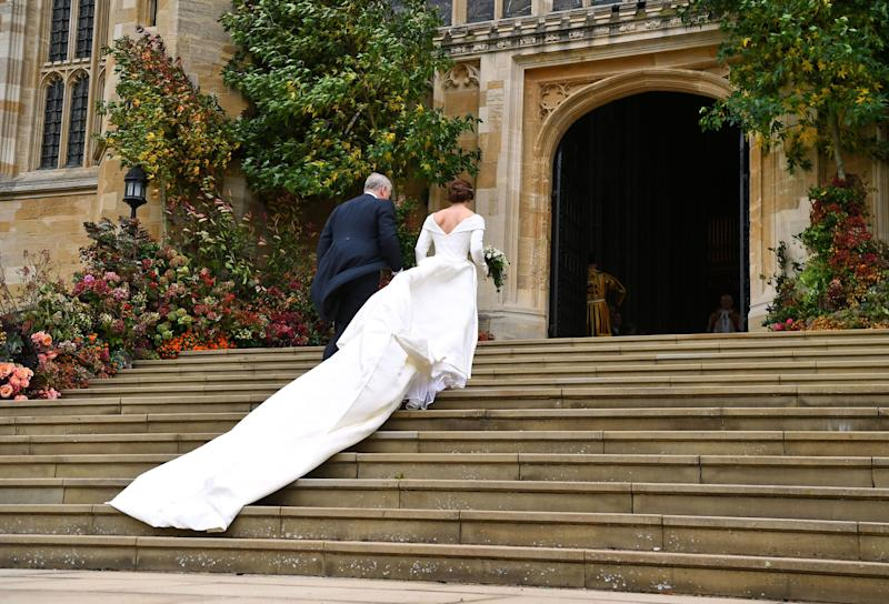 Prince Andrew and Princess Eugenie ascend the stairs together.