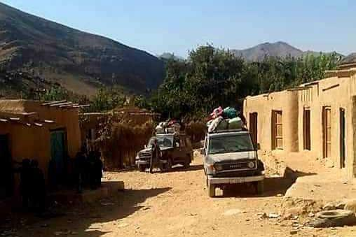 A photo taken by Mohammad purportedly shows Hazara families in Afghanistan's Daykundi province leaving their homes after the Taliban ordered them to evacuate their houses this month. (Obtained by NBC News)