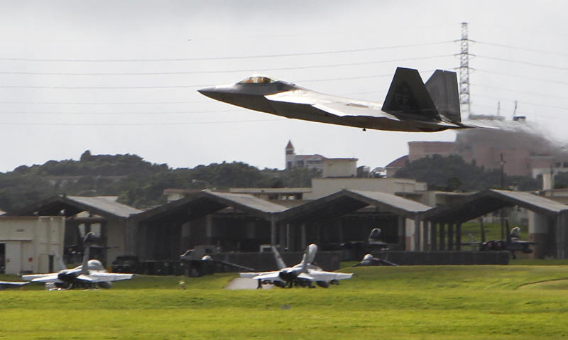 In this Aug. 14, 2012 photo, a U.S. Air Force F-22 Raptor takes off near other fighter jets at Kadena Air Base on the southern island of Okinawa, in Japan.  The deployment of a dozen F-22 stealth fighters to Japan has so far gone off without a hitch as the aircraft are being brought back into the skies in their first overseas mission since restrictions were imposed over incidents involving pilots getting dizzy and disoriented, a senior U.S. Air Force commander told the Associated Press on Thursday, Aug. 30, 2012.  (AP Photo/Greg Baker)