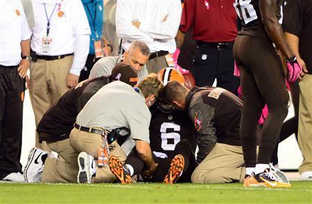 Oct 3, 2013; Cleveland, OH, USA; Cleveland Browns quarterback Brian Hoyer (6) is attended to by medical staff after being injured during the first quarter against the Buffalo Bills at FirstEnergy Stadium. Mandatory Credit: Andrew Weber-USA TODAY Sports