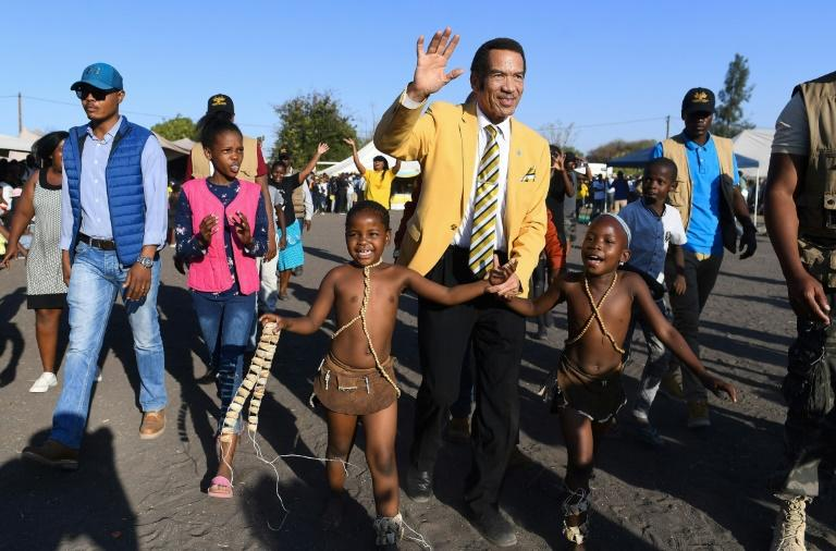 Botswana former president Ian Khama (C) has quit the BDP and thrown his support behind its strongest rival -- opposition coalition Umbrella for Democratic Change (UDC)