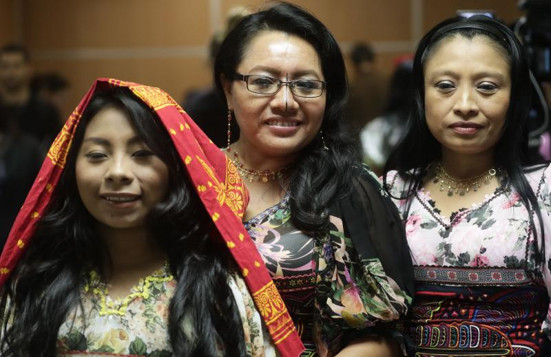 "Guna indigenous women pose for a photo wearing traditional dresses decorated with Molas, after a press conference where Guna leaders demanded that the sports shoe company Nike remove their traditional Mola handcraft print from a shoe design, in Panama City, Tuesday, May 21, 2019. Nike said in a statement that it has canceled the launch of the ""Nike Air Force 1 'Puerto Rico"" trainer, with which it intended to pay homage to Puerto Rico. (AP Photo/Arnulfo Franco)"