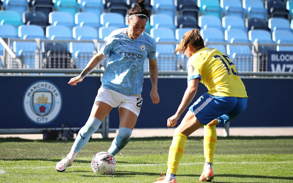 Manchester City's Lucy Bronze (left) and Brighton and Hove Albion's Kayleigh Green battle for the ball - PA