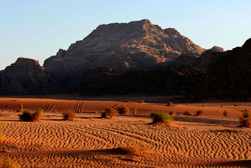 In this photo taken Sunday, June 26, 2011, the sun sets on Wadi Rum, south of Amman, Jordan. UNESCO named Wadi Rum one of five new World Heritage sites on Saturday, June 25, 2011. (AP Photo/Nader Daoud)