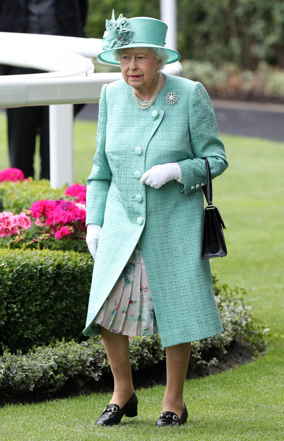 <p>On day four of Royal Ascot 2017, the Queen dressed in a more muted colour palette: A duck egg coat and matching hat. <br><em>[Photo: PA]</em> </p>
