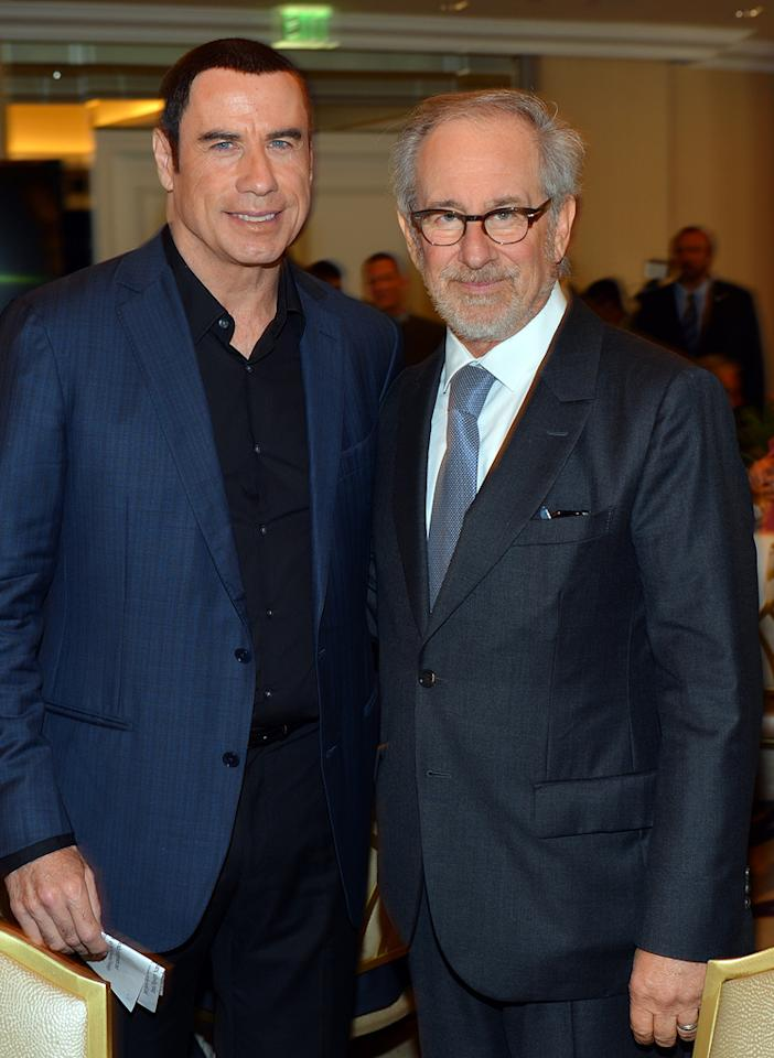 John Travolta and Steven Spielberg attend at the Hollywood Foreign Press Association's 2012 Luncheon held at the Beverly Hill Hotel on August 9, 2012.