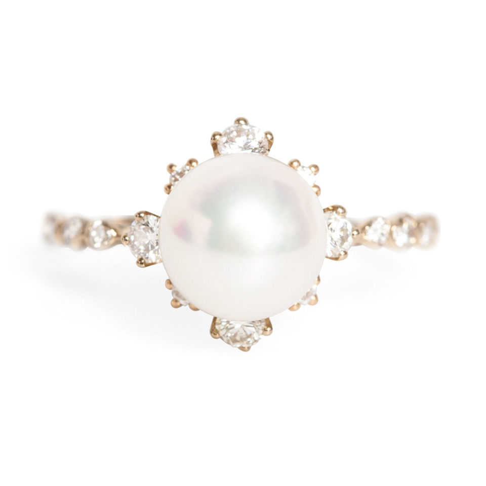 "This is Emma Stone's very engagement ring, and yes, it's still available. <br><br><strong>Kataoka</strong> Winter Pearl Ring, $, available at <a href=""https://go.skimresources.com/?id=30283X879131&url=https%3A%2F%2Fwww.catbirdnyc.com%2Fwinter-pearl-ring-7.html"" rel=""nofollow noopener"" target=""_blank"" data-ylk=""slk:Catbird"" class=""link rapid-noclick-resp"">Catbird</a><span class=""copyright"">Photo Courtesy of Catbird.</span>"