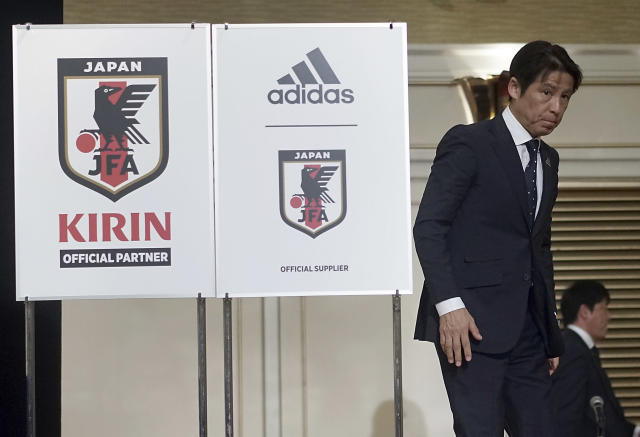 Japanese national soccer coach Akira Nishino walks away from the a press conference venue Friday, May 18, 2018, in Tokyo. Keisuke Honda and Shinji Kagawa were named on Friday to Japan's squad for an international friendly on May 30 against Ghana in Yokohama.(AP Photo/Eugene Hoshiko)