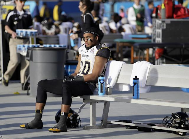 Towson wide receiver DeAngelo Stephenson (20) sits on the bench late in the second half of the FCS championship NCAA college football game against North Dakota State, Saturday, Jan. 4, 2014, in Frisco, Texas. NDSU won 35-7. (AP Photo/Tony Gutierrez)