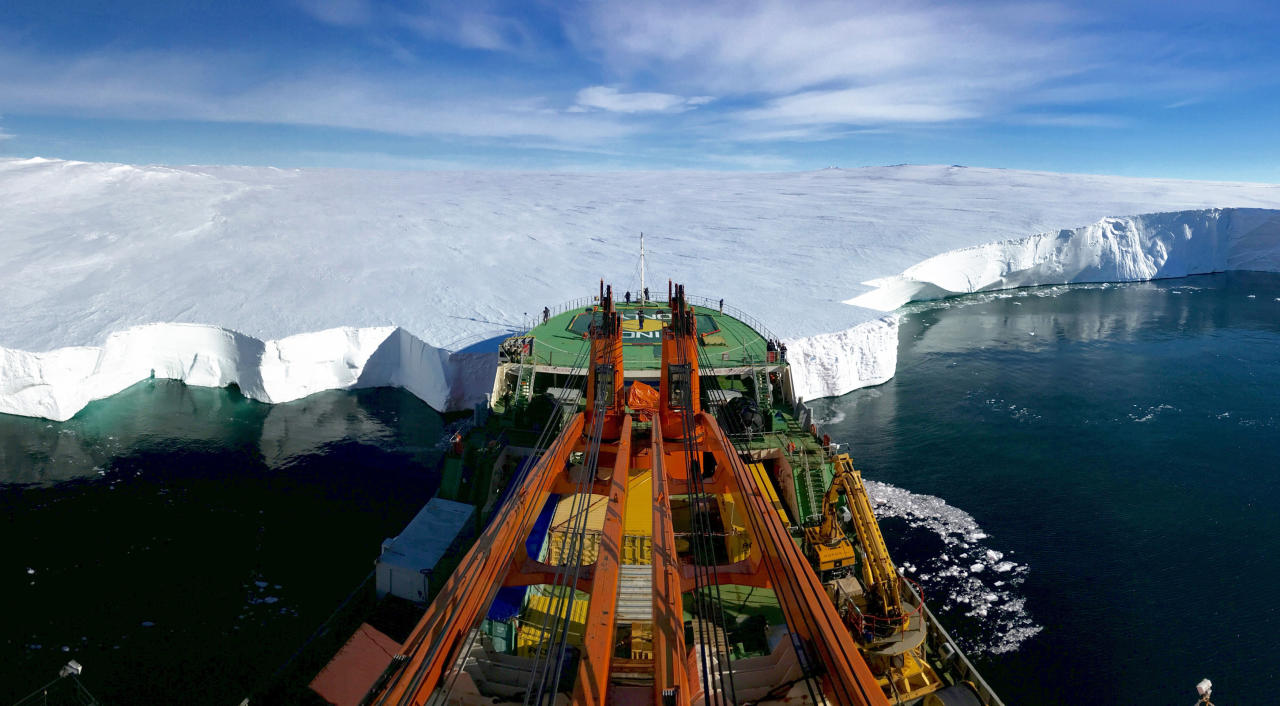 <p>The Russian research vessel Akademik Tryoshnikov leans the bow against the Mertz Glacier's snout in Eastern Antarctica. The photo was taken moments before deploying ROPOS, a Remotely Operated Underwater Vehicle (ROV) under the glacier tongue to investigate the melting of the ice-sheet after a piece of ice protruding 100 kilometres (62 miles) out into the Southern Ocean broke away from the main body of the tongue in 2010. It was named as runner up in the Earth Science and Climatology category. (PA) </p>