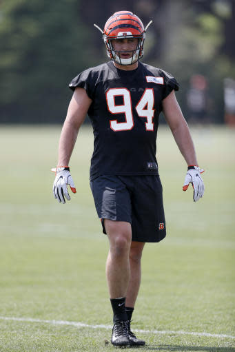 Cincinnati Bengals defensive end Sam Hubbard participates in the NFL football team's rookie minicamp, Friday, May 11, 2018, in Cincinnati. Hubbard was playing dodgeball when Ohio State coach Urban Meyer first noticed him. He wound up playing defensive end for the Buckeyes and now he will be suiting up for his hometown Bengals. (AP Photo/John Minchillo)