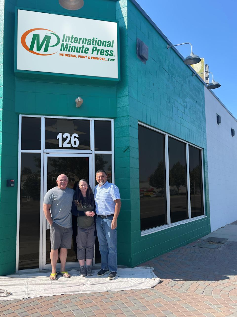Custom Printing is now International Minute Press, Nampa, Idaho. Pictured from left to right: Mike Cutler, retiring owner of Custom Printing; and Sheryl & James Wisler, new owners of International Minute Press, Nampa.