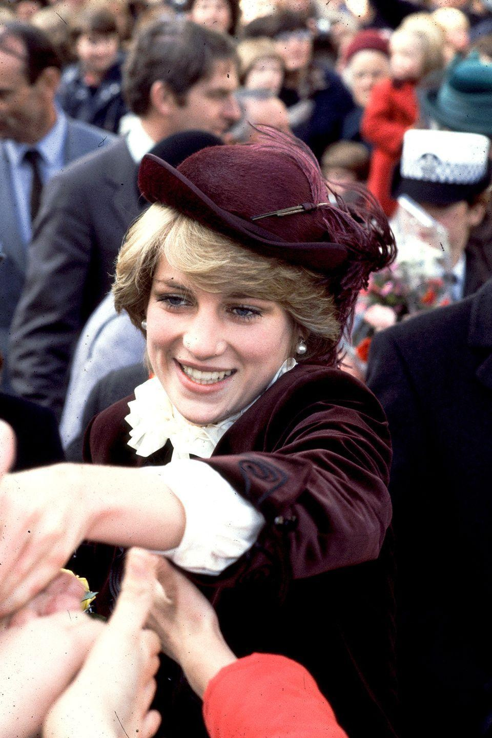<p>In a plum John Boyd hat while greeting crowds.</p>