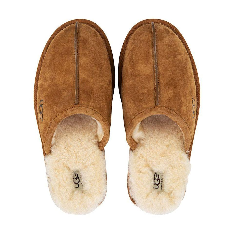 """<p><strong>UGG</strong></p><p>amazon.com</p><p><strong>79.95</strong></p><p><a href=""""http://www.amazon.com/dp/B0026FBI3U/?tag=syn-yahoo-20&ascsubtag=%5Bartid%7C2089.g.2100%5Bsrc%7Cyahoo-us"""" rel=""""nofollow noopener"""" target=""""_blank"""" data-ylk=""""slk:Shop Now"""" class=""""link rapid-noclick-resp"""">Shop Now</a></p><p>UGG shoes are crafted using sustainable, luxury materials, so there's no doubt the man in your life will have these slippers for many years to come. Thank goodness for their superior quality — because once he slips his feet into these cozy shearling mules, he won't want to take them off.</p>"""
