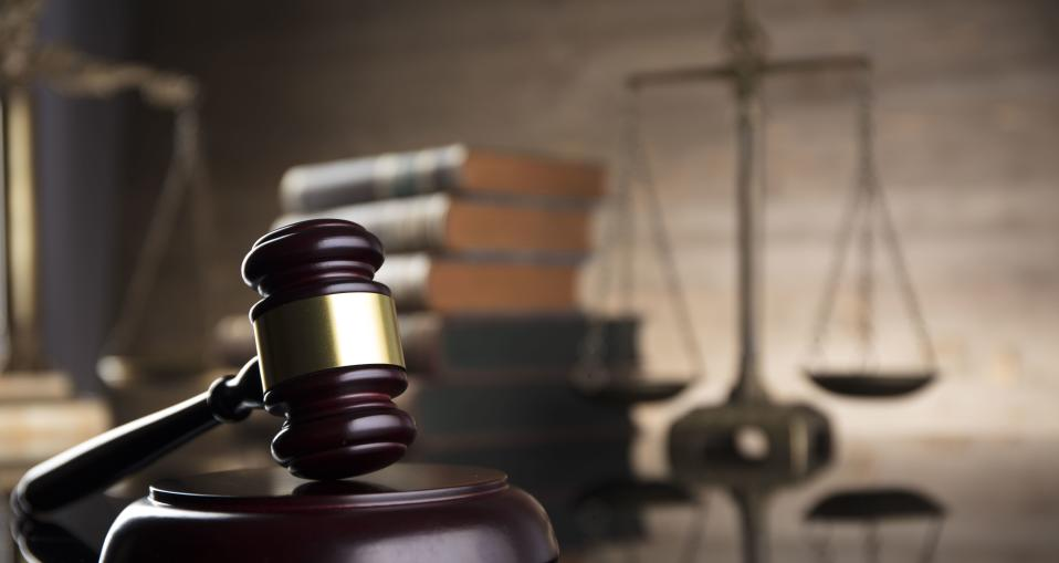 A judge's gavel with the scales of justice in background. (PHOTO: Getty Images)