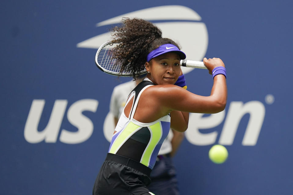 FILE - Naomi Osaka, of Japan, returns a shot to Victoria Azarenka, of Belarus, during the women's singles final of the U.S. Open tennis championships in New York, in this Saturday, Sept. 12, 2020, file photo. Three-Time Grand Slam singles champion Naomi Osaka has invested in the North Carolina Courage of the National Women's Soccer League, citing the importance of supporting women as role models and leaders. (AP Photo/Seth Wenig, File)
