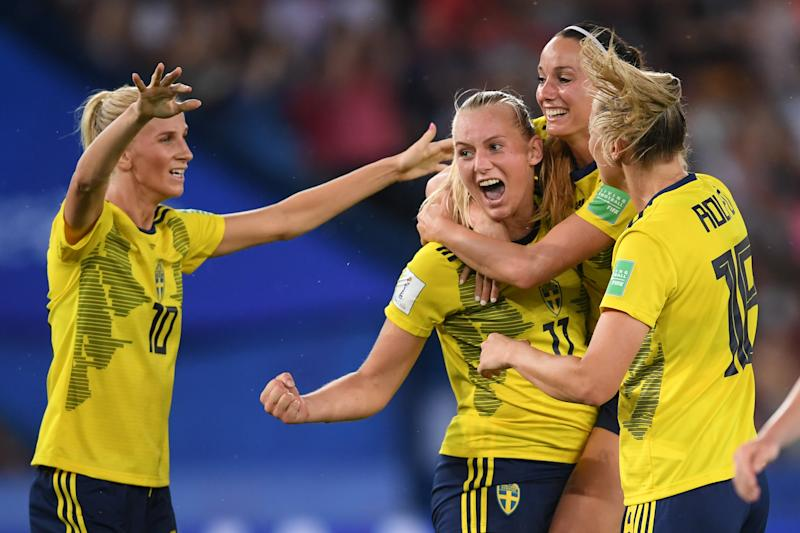 PARIS, FRANCE - JUNE 24: Stina Blackstenius of Sweden celebrates with teammate Kosovare Asllani after scoring her team's first goal during the 2019 FIFA Women's World Cup France Round Of 16 match between Sweden and Canada at Parc des Princes on June 24, 2019 in Paris, France. (Photo by Laurence Griffiths/Getty Images)