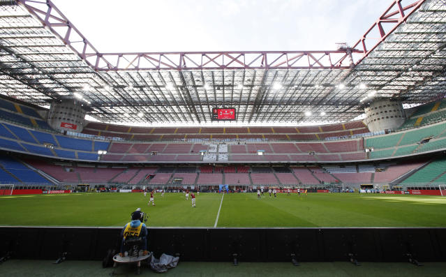 FILE - In this Sunday, March 8, 2020 filer, a view of the empty stadium during the Serie A soccer match between AC Milan and Genoa at the San Siro stadium, in Milan, Italy. While soccer leagues around Europe are still debating whether and when to resume playing, the leader of the continents Federation of Sports Medicine Associations is calling for a detailed series of tests to clear athletes for a return to training. Maurizio Casasco, who is also president of the Italian Federation of Sports Medicine, said that guidelines recently published by his domestic federation should be extended for all of Europe -- especially if UEFA intends to resume the Champions League and Europa League anytime soon. (AP Photo/Antonio Calanni, File)