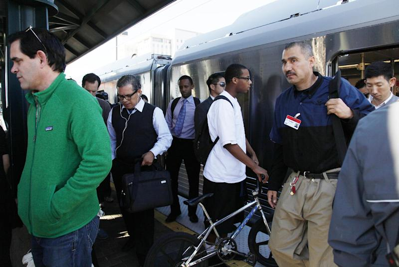 In this photo taken March 13, 2013, commuters from the Red Line train arrive at Union Station in downtown Los Angeles. An historic decline in the number of U.S. whites and the fast growth of Latinos are blurring traditional black-white color lines, testing the limits of civil rights laws and reshaping political alliances as whiteness begins to lose its numerical dominance. (AP Photo/Nick Ut)