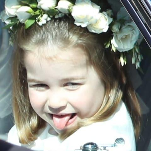 Princess Charlotte cheekily sticks her tongue out as she arrived at the wedding - Credit: Andrew Milligan/PA