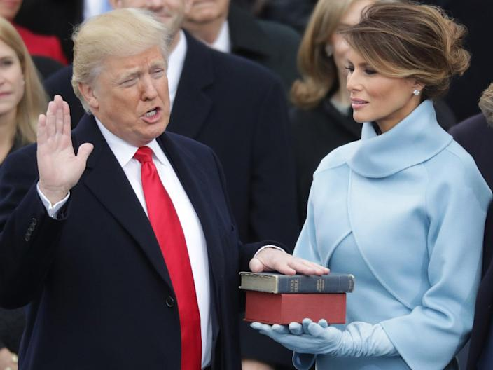 <p>Donald Trump's inauguration on 20 January, 2017, was attended by his defeated rival Hillary Clinton and all living former presidents. He is weighing up whether to extend the same courtesy to Joe Biden.</p> (Getty)