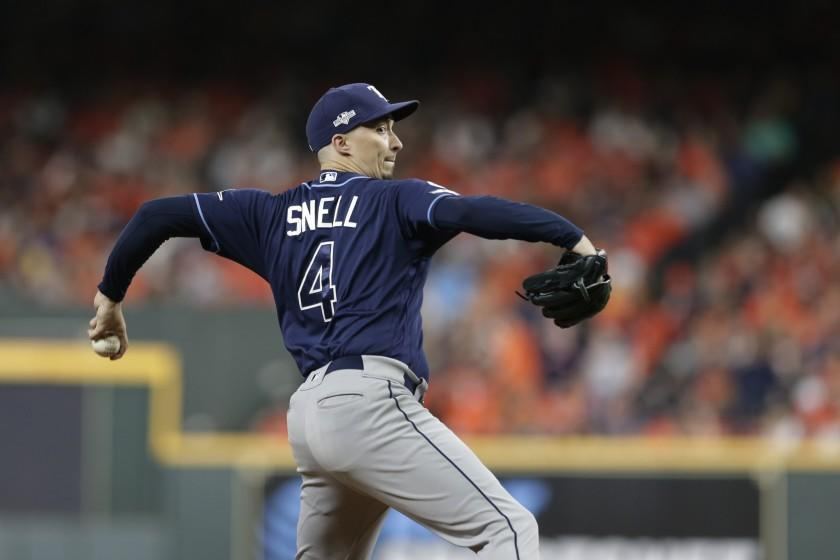 Tampa Bay Rays starting pitcher Blake Snell (4) pitches against the Houston Astros during the third inning of Game 5 of a baseball American League Division Series in Houston, Thursday, Oct. 10, 2019. (AP Photo/Michael Wyke)