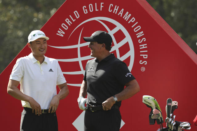 Li Haotong of China, left, and Phil Mickelson of the United States chat before they tee off for the HSBC Champions golf tournament at the Sheshan International Golf Club in Shanghai on Thursday, Oct. 31, 2019. Li gave the home crowd plenty to cheer Thursday with an 8-under 64 to build a one-shot lead in the HSBC Champions. Li practically grew up with this World Golf Championship, posing with Phil Mickelson as a junior 10 years ago and threatening to win in 2015 at age 20.(AP Photo/Ng Han Guan)
