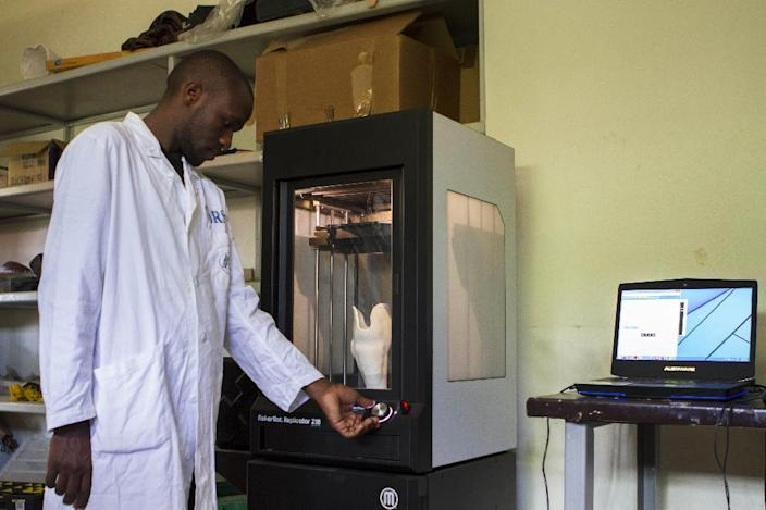 An infrared scanner, a laptop and a pair of 3D printers are changing everything for people with amputations, offering them the chance of a near-normal life in Uganda (AFP Photo/Isaac Kasamani)