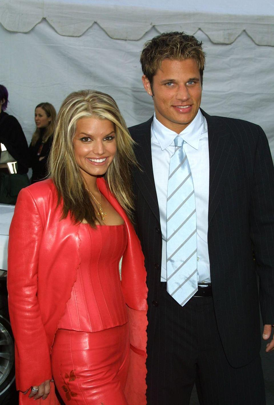 <p>The <em>Newlyweds</em> stars gave us pure early-aughts gold with Nick's frosted tips and Jessica's *entire* red leather ensemble as the pair walked the carpet at the 28th Annual American Music Awards.</p>