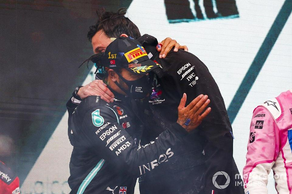 "Race Winner Lewis Hamilton, Mercedes-AMG F1 and Toto Wolff, Executive Director (Business), Mercedes AMG celebrate on the podium<span class=""copyright"">Steven Tee / Motorsport Images</span>"