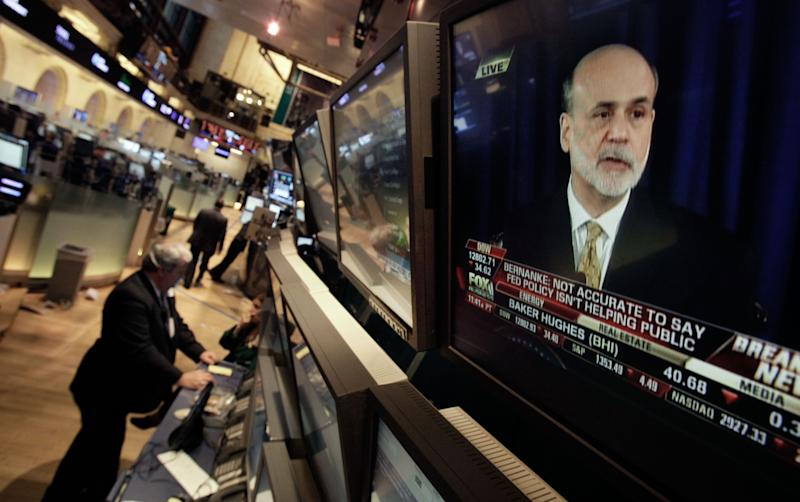 FILE - In this Wednesday, June 20, 2012, file photo, Federal Reserve chairman Ben Bernanke is visible on a television monitor on the floor of the New York Stock Exchange. Futures augured a weak start Thursday June 21, 2012 on Wall Street with Dow futures nearly unchanged at 12,765. S&P 500 futures dropped 0.5 percent to 1,343.50.  (AP Photo/Richard Drew, File)