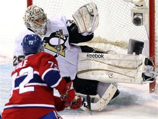 Montreal Canadiens right wing Erik Cole (72) has his shot stopped by Pittsburgh Penguins goalie Marc-Andre Fleury (29) during the second period of an NHL hockey game Tuesday, Feb. 7, 2012, in Montreal. (AP Photo/The Canadian Press, Ryan Remiorz)