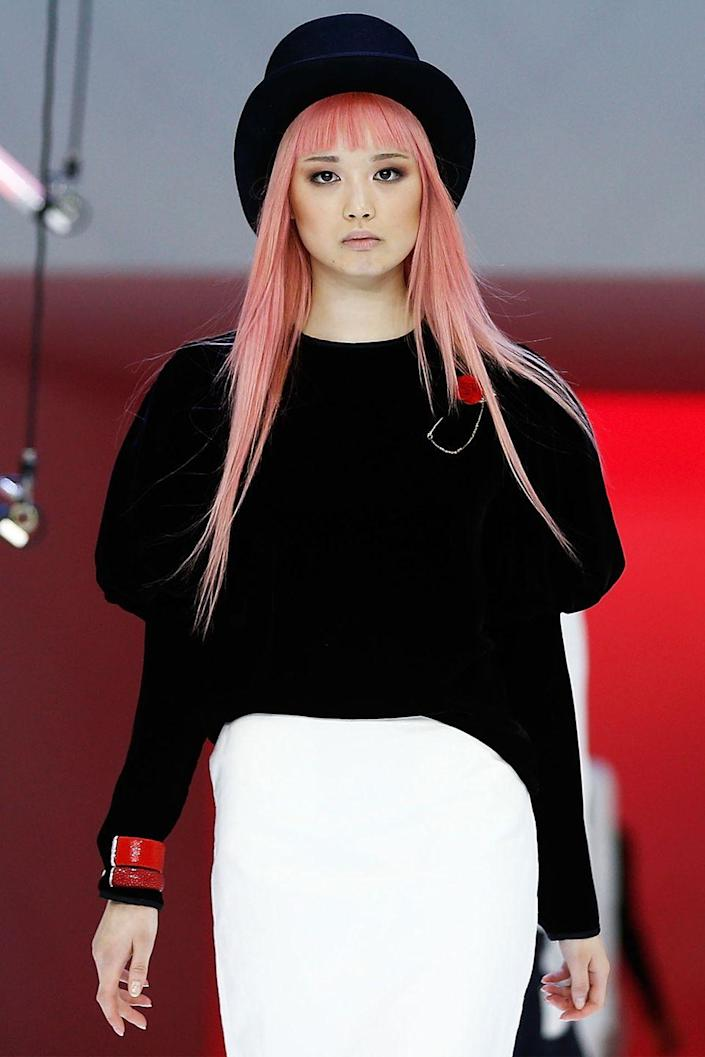 """<p>You can thank Ly's signature <a href=""""https://www.allure.com/story/modern-muses"""" rel=""""nofollow noopener"""" target=""""_blank"""" data-ylk=""""slk:bubblegum pink hair"""" class=""""link rapid-noclick-resp"""">bubblegum pink hair</a> for kick-starting her modeling career. She was scouted while shopping at the mall with her mom, gaining attention for her bright locks. After <a href=""""https://www.teenvogue.com/story/fernanda-ly-model-dec-jan-cover"""" rel=""""nofollow noopener"""" target=""""_blank"""" data-ylk=""""slk:earning the approval of a famous casting director"""" class=""""link rapid-noclick-resp"""">earning the approval of a famous casting director</a>, Ly decided to pursue modeling more vigorously. </p>"""