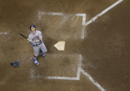 New York Mets' Brandon Nimmo looks up after hitting a pop up during the 10th inning of a baseball game against the Milwaukee Brewers Friday, May 25, 2018, in Milwaukee. (AP Photo/Morry Gash)
