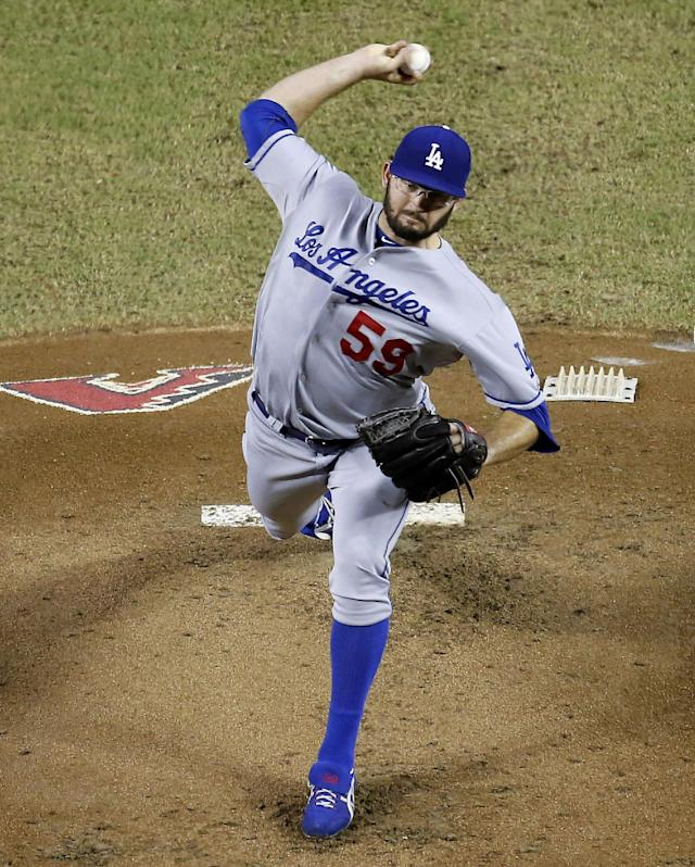 Los Angeles Dodgers pitcher Stephen Fife delivers against the Arizona Diamondbacks during the first inning of a baseball game on Wednesday, Sept. 18, 2013, in Phoenix. (AP Photo/Matt York)