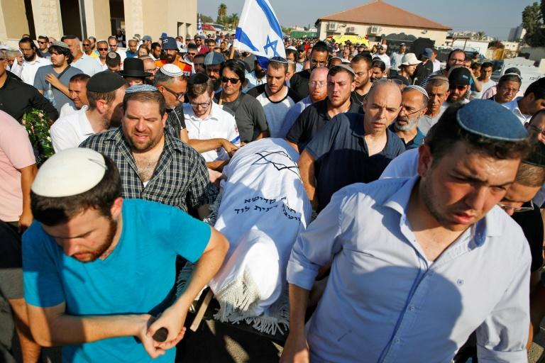 Mourners carry the body of 17-year-old Israeli Rina Shnerb, who was killed in a bomb blast near the Jewish settlement of Dolev, northwest of Ramallah in the occupied West Bank