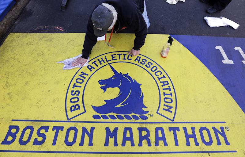 Pepi Bolognese cleans the finish line before the running of the 118th Boston Marathon Monday, April 21, 2014 in Boston. (AP Photo/Robert F. Bukaty)