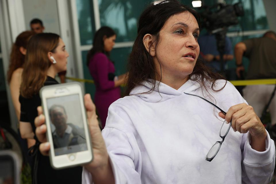 Soriya Cohen shows a picture of her husband, Brad Cohen, who she said is missing after the partial collapse of the 12-story condo tower that he was in on June 24, 2021 in Surfside, Florida. (Getty Images)