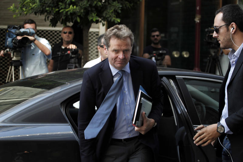 International Monetary Fund (IMF) mission chief Poul Thomsen arrives for a meeting between Greece's Finance Minister Yannis Stournaras and the debt inspectors from the European Central Bank, European Commission and International Monetary Fund, known as the troika at Greece's Finance ministry in Athens, on Sunday, Sept. 9, 2012. Greek Prime Minister Antonis Samaras said that the last round of austerity measures contains painful and unjust cuts in wages and pensions but is necessary for Greece to restore its credibility and continue to receive much needed funding from its creditors.(AP Photo/Petros Giannakouris)