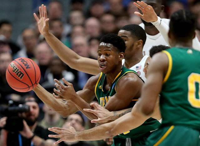 <p>Ben Shungu #24 of the Vermont Catamounts passes the ball against the Florida State Seminoles in the first round game of the 2019 NCAA Men's Basketball Tournament at XL Center on March 21, 2019 in Hartford, Connecticut. (Photo by Rob Carr/Getty Images) </p>