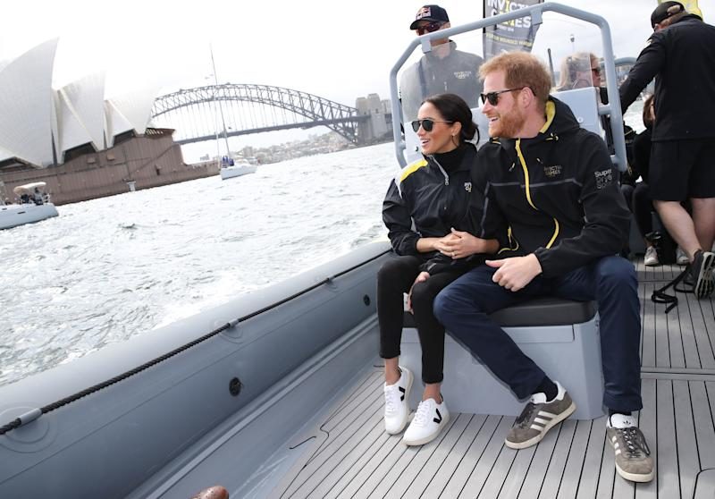 The Duke and Duchess of Sussex watch competitors taking part in a sailing event at the 2018 Invictus Games in Sydney harbour.