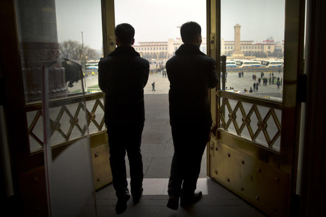 <p>Security officials push open the doors of the Great Hall of the People at the end of a plenary session of China's National People's Congress (NPC) in Beijing on March 9, 2018. (Photo: Mark Schiefelbein/AP) </p>
