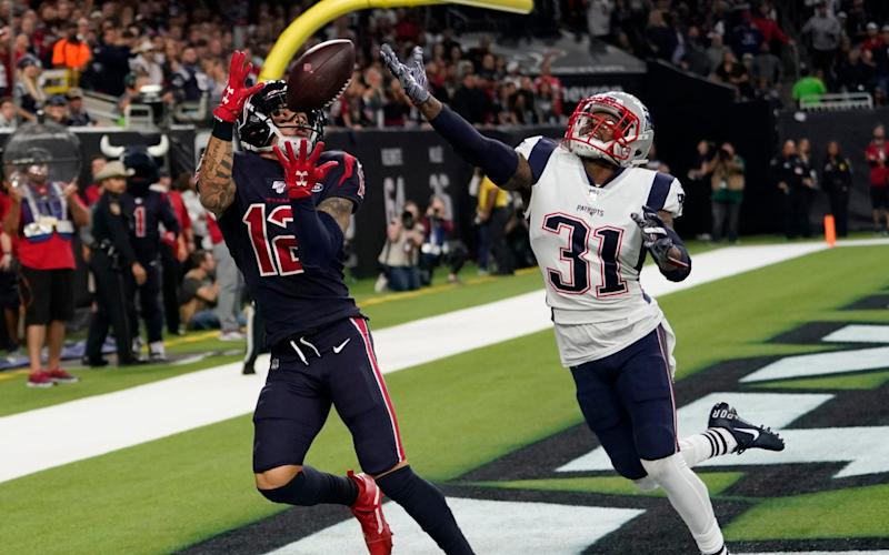 Kenny Stills catches a touchdown pass in the Houston Texans' win over the New England Patriots - AP